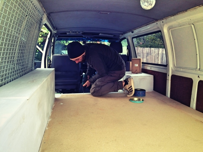 Putting the bed frame back into campervan