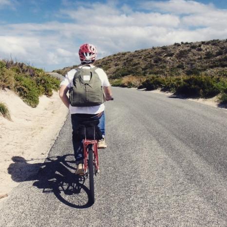 Gareth on bike with backpack, Rottnest Island, Western Australia