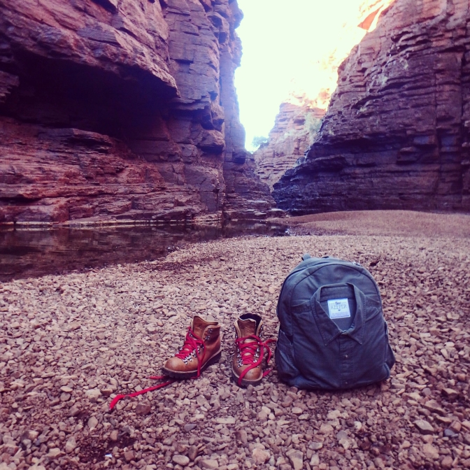 Hiking boots and backpack, Karijini National Park, Western Australia