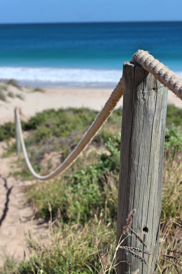Wooden rope fence Red Bluff beach Western Australia