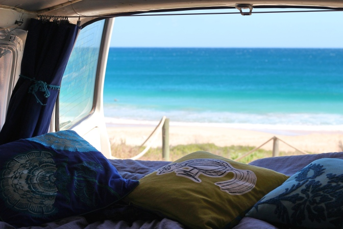 Rear campervan view looking out to water Red Bluff Western Australia