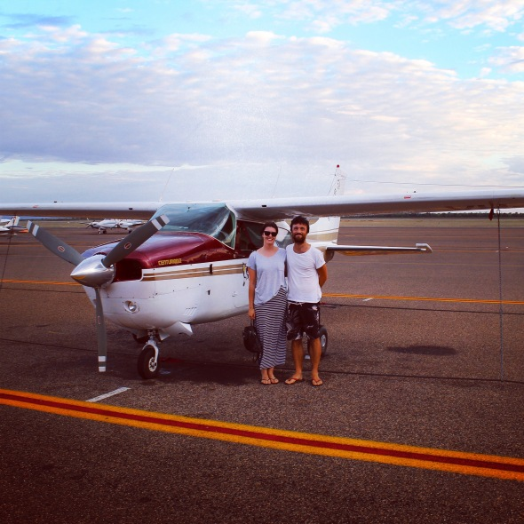 Couple in front of plane, Kununurra, Western Australia