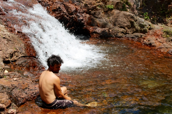 Man in rockpool, Litchfield National Park, Northern Territory