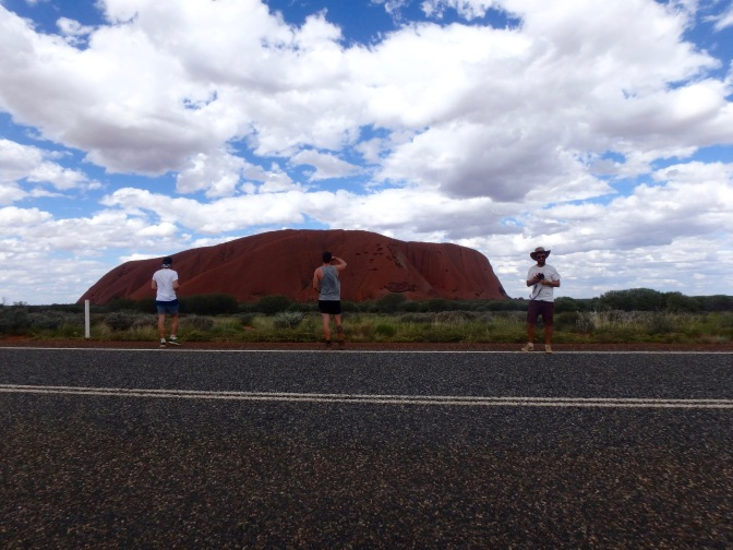 Three people in front on Uluru Northern Territory