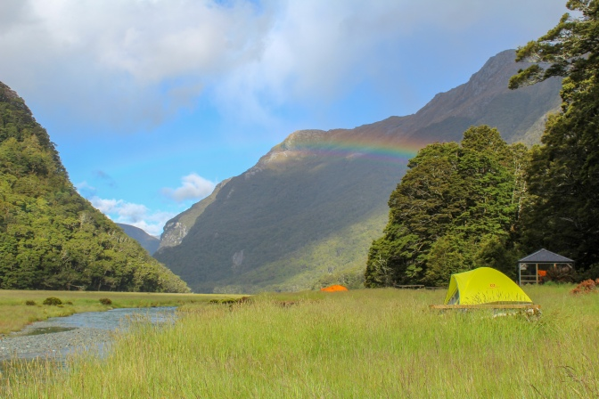 Meadow campsite with rainbow, Routeburn Track